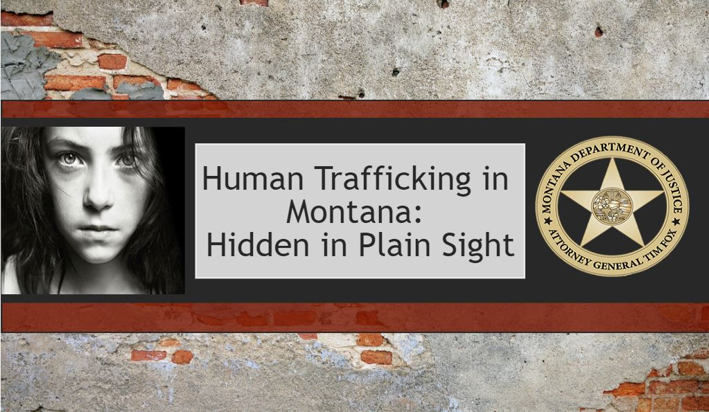 brick wall with a poster of a girl that reads human trafficking in montana: hidden in plain sight